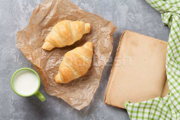 Fresh croissants, milk and old book Stock photo © karandaev