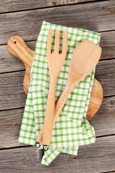 Cooking utensils on wooden table Stock photo © karandaev
