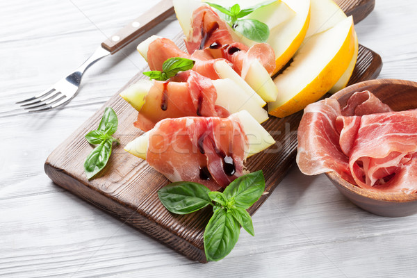 Fresh melon with prosciutto and basil Stock photo © karandaev