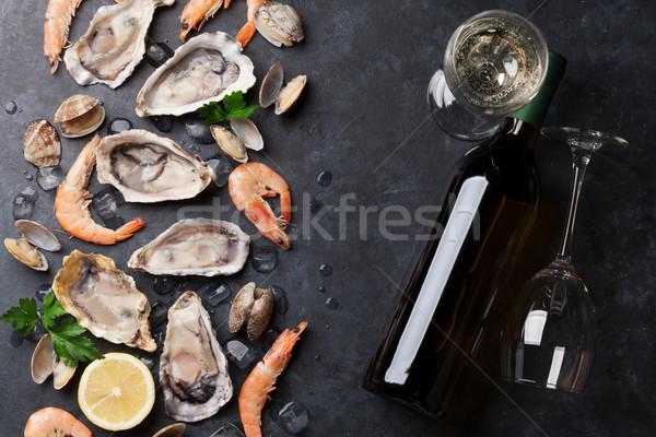 Fresche frutti di mare vino bianco pietra tavola Foto d'archivio © karandaev