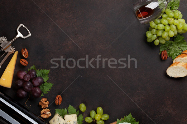 Stock photo: Wine bottle, grape and cheese