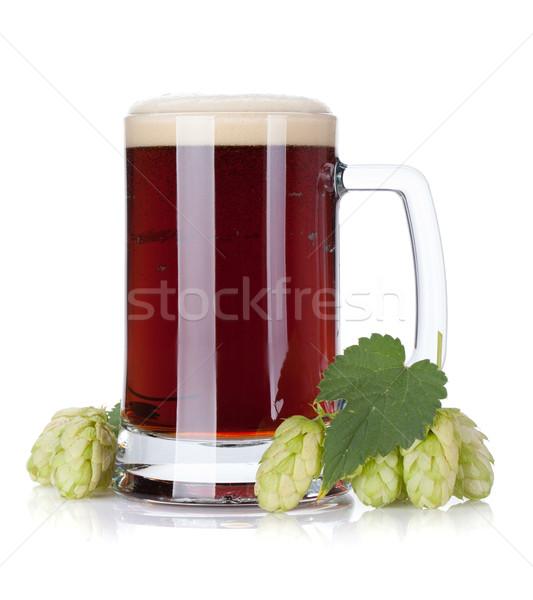 Dark beer mug and hop branch Stock photo © karandaev