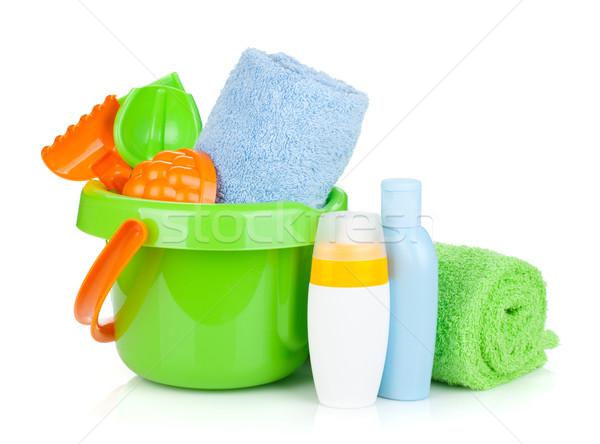 Beach baby toys, towels and bottles Stock photo © karandaev
