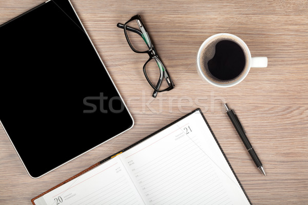 Tablet, notepad, glasses and coffee cup Stock photo © karandaev