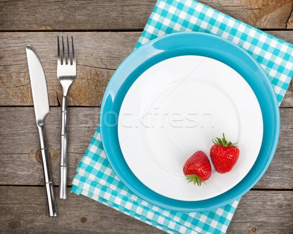 Plate with ripe strawberry and silverware Stock photo © karandaev