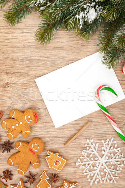 Christmas fir tree, gingerbread cookies and card for copy space Stock photo © karandaev