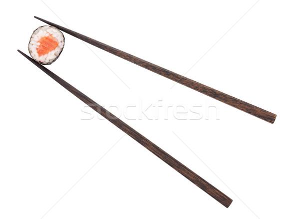 Maki sushi somon Çin yemek çubukları yalıtılmış beyaz Stok fotoğraf © karandaev
