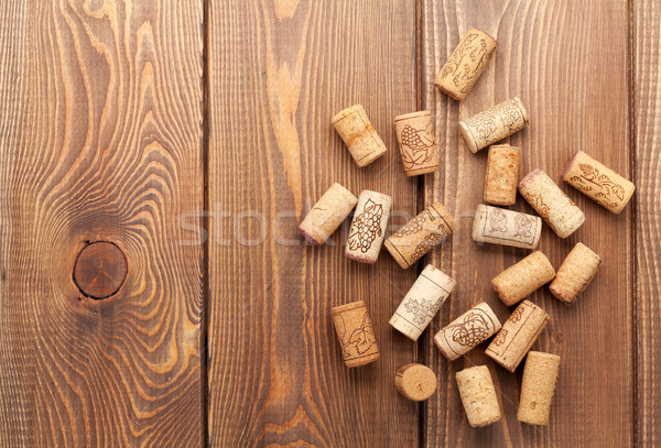 Stock photo: Wine corks over rustic wooden table background