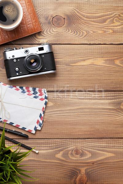 Camera and supplies on office wooden desk Stock photo © karandaev