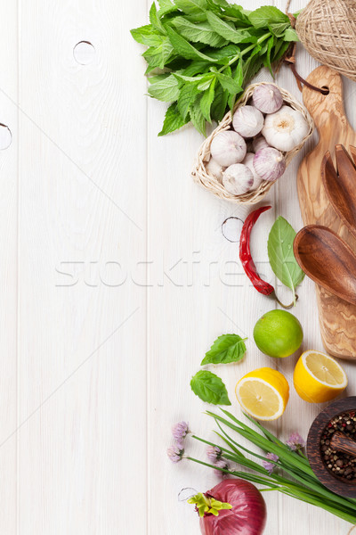 Fresh herbs and spices on wooden table Stock photo © karandaev