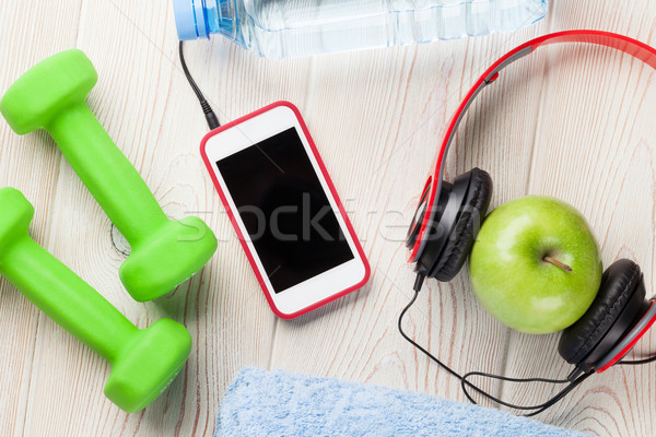 Dumbbells, water, apple and smartphone Stock photo © karandaev