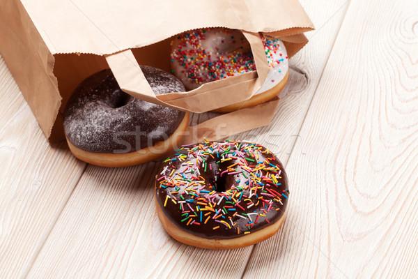 ストックフォト: カラフル · ドーナツ · 袋 · 木製のテーブル · 食品 · ケーキ