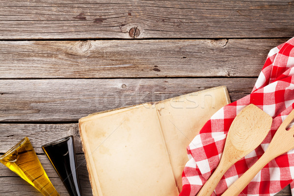 Kitchen table with cookbook, utensils and ingredients Stock photo © karandaev