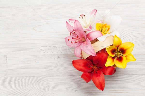Kleurrijk lelie bloemen mand houten ruimte Stockfoto © karandaev