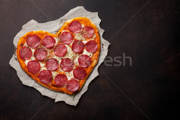 Heart shaped pizza with pepperoni Stock photo © karandaev