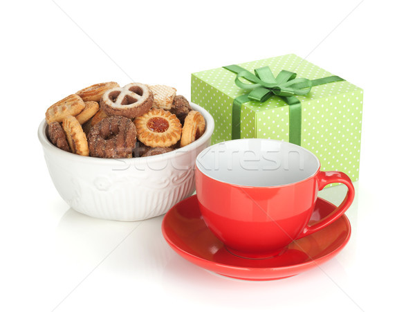 Stock photo: Various cookies, red tea cup and green gift box