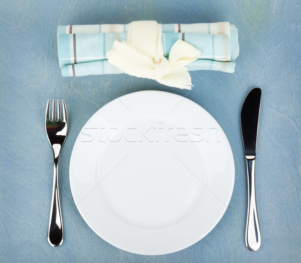 Vide blanche plaque argenterie table en bois bleu Photo stock © karandaev