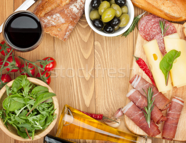 Red wine with cheese, olives, tomatoes, prosciutto, bread and sp Stock photo © karandaev