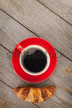 Cup of coffee and fresh croissant Stock photo © karandaev