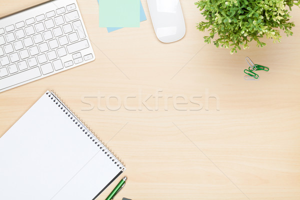 Office table with notepad, computer and flower Stock photo © karandaev