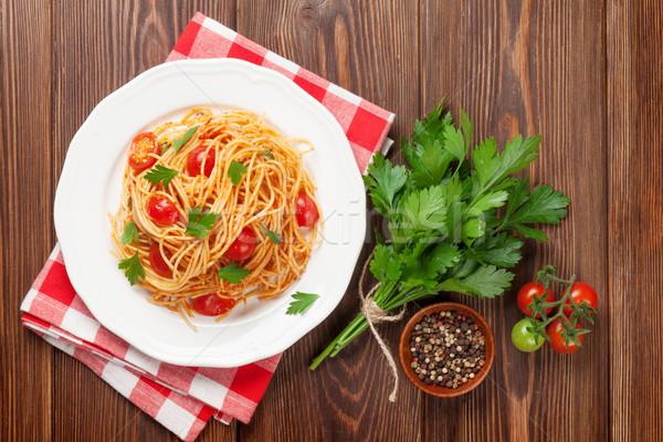 Espaguetis pasta tomates perejil mesa de madera superior Foto stock © karandaev