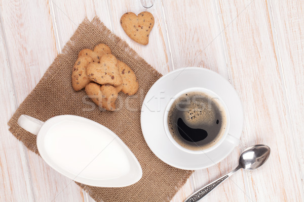 Coffee cup, heart shaped gingerbread cookies and milk pitcher Stock photo © karandaev