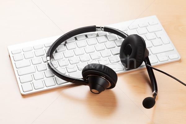Office desk with headset and keyboard Stock photo © karandaev
