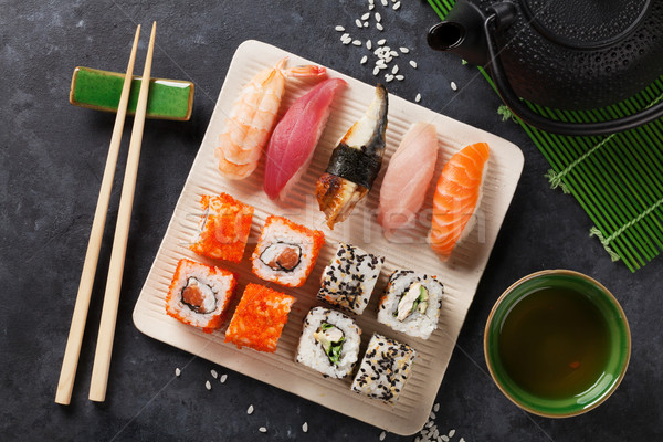Set sushi maki tè verde pietra tavola Foto d'archivio © karandaev
