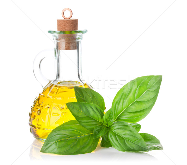 Garden basil and olive oil Stock photo © karandaev