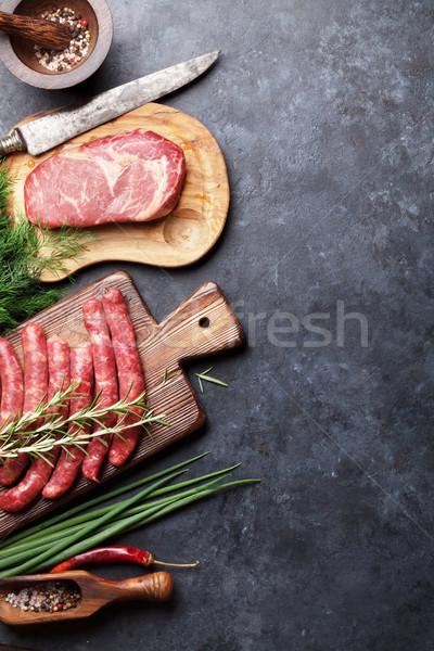 Kolbászok hús főzés hozzávalók felső kilátás Stock fotó © karandaev
