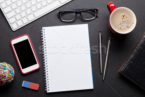 Stock photo: Office desk table with pc, notepad, glasses, coffee and phone