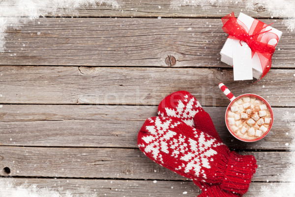 Christmas background with mittens, gift and hot chocolate Stock photo © karandaev