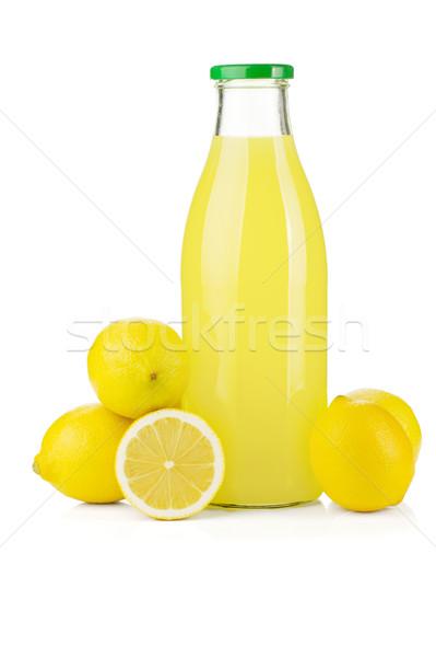 Bottle of lemon juice and fresh lemons Stock photo © karandaev