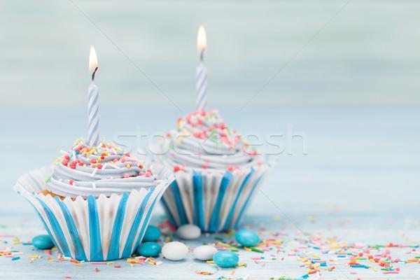 Sweet cupcakes with candles Stock photo © karandaev