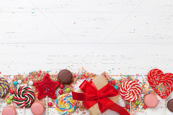 Colorful sweets and gift box Stock photo © karandaev