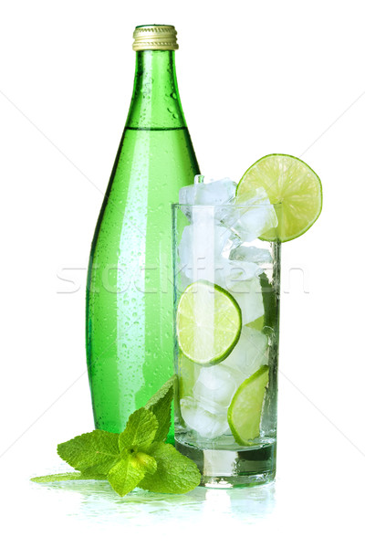 Glass of water with lime, ice and mint Stock photo © karandaev