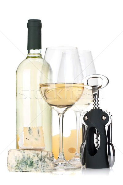 White wine bottle, two glasses, cheese and corkscrew Stock photo © karandaev