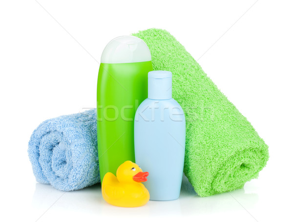 Bath bottles, towel and rubber duck Stock photo © karandaev