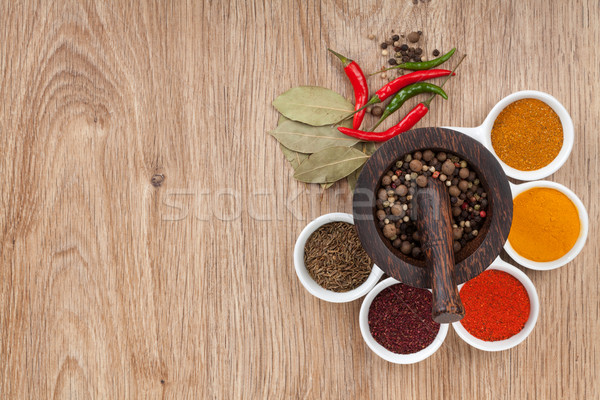Mortar and pestle with pepper and spices Stock photo © karandaev