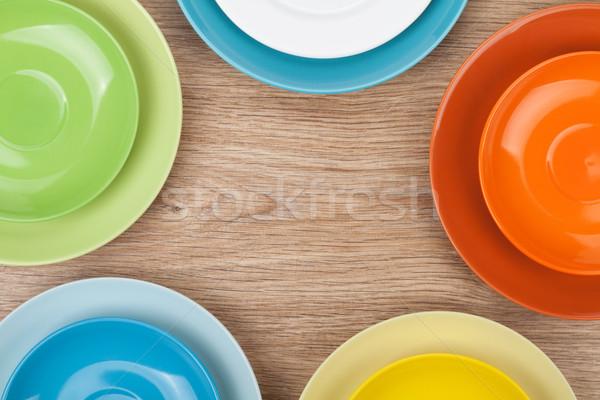 Colorido placas mesa de madeira cópia espaço comida Foto stock © karandaev
