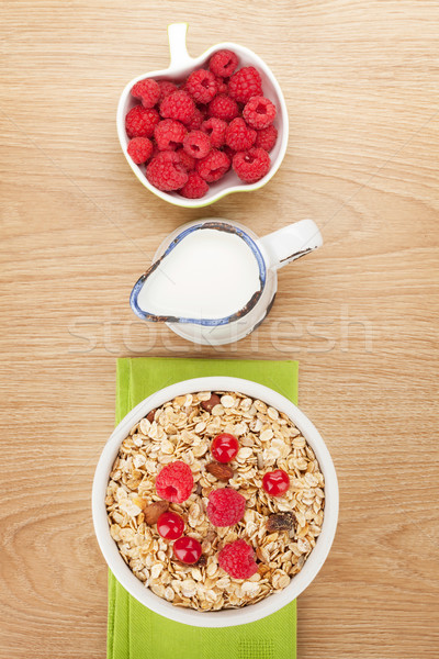 Stock photo: Healty breakfast with muesli, berries and milk