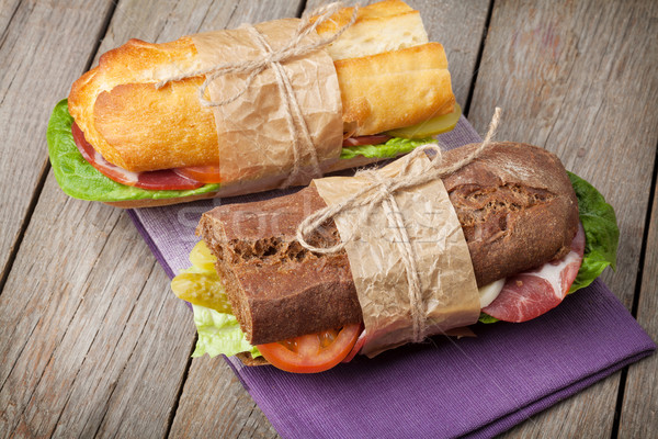 Two sandwiches with salad, ham, cheese and tomatoes Stock photo © karandaev
