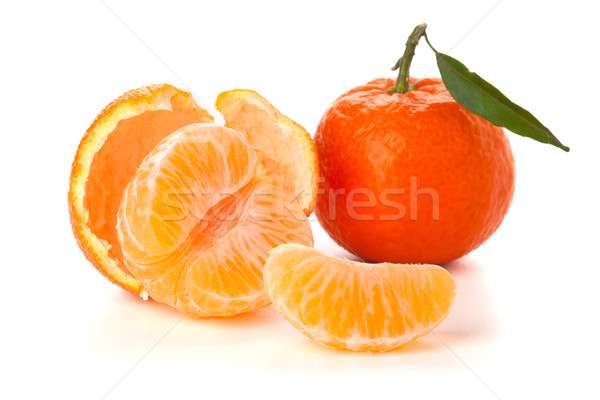 Ripe tangerines with green leaf Stock photo © karandaev