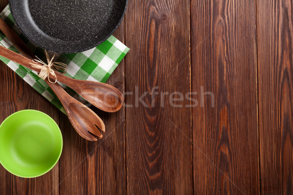 Cooking utensil on wooden table Stock photo © karandaev