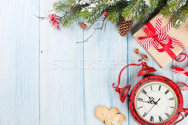Christmas gift box, alarm clock and tree branch Stock photo © karandaev