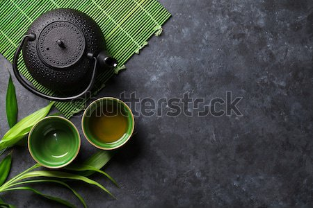 ázsiai teáskanna kő asztal bambusz növény Stock fotó © karandaev