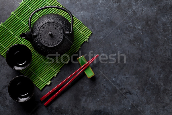 Green tea and sushi chopsticks Stock photo © karandaev