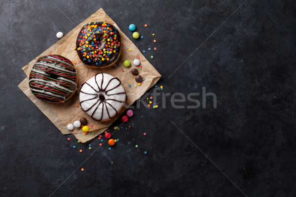 Colorful donuts and candies Stock photo © karandaev