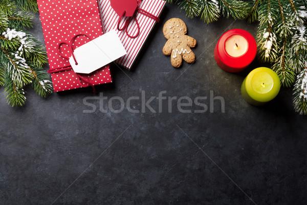 Karácsony gyertyák ajándékdobozok hó fenyőfa kő Stock fotó © karandaev