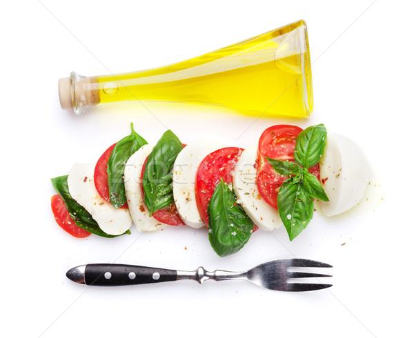 Caprese salatası zeytinyağı çatal mozzarella peynir domates Stok fotoğraf © karandaev